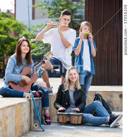 Young girls and boys with musical instruments 37058109