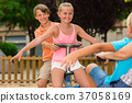 Children are teetering on the swing 37058169