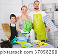 Smiling family standing, ready to cleaning 37058299