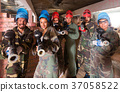 Portrait of friends who are ready for paintball 37058522