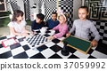 children play in the chess quest room 37059992