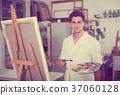 Artist painting on canvas 37060128