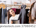 Woman buying breeches at the store . 37060452