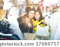 Family enjoying purchases in shop 37060757