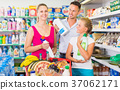 Smiling people showing household goods purchase 37062171