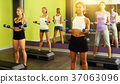 Girls exercising with dumbbells 37063096