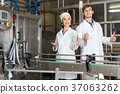 man and woman working on factory 37063262