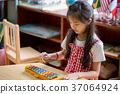 Happy Asian Children playing on colorful xylophone 37064924