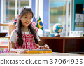 Happy Asian Children playing on colorful xylophone 37064925