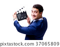 Handsome man with movie clapper isolated on white 37065809