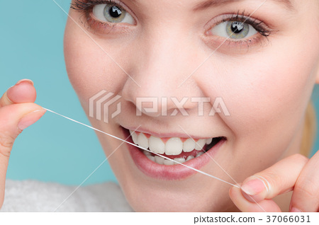Woman face smiling with dental floss. 37066031
