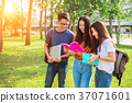 Three Asian young campus people tutoring 37071601
