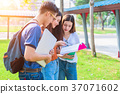 Three Asian young campus people tutoring 37071602