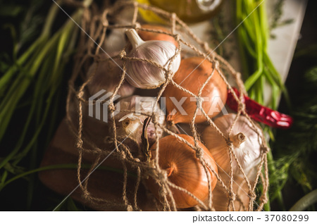 Raw Garlic, onion, dill and parsley for soup for 37080299
