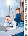 family, kid, laptop 37081129