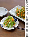 Carrot and carrot leaf tempura / carrot and carrot leaves tempura 37082069