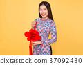 Vietnamese woman traditional festival costume Ao Dai holding att 37092430