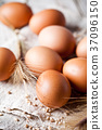 fresh brown eggs, wheat seeds and ears 37096150