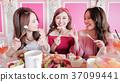 women chatting in restaurant 37099441