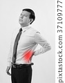 business man with back pain, spinal injury 37109777
