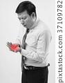 man with trigger finger, arthritis, wrist pain 37109782
