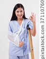 injured woman patient pointing up ok hand gesture 37110760