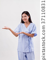 woman patient pointing or showing hand gesture to blank space 37110831