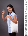 happy woman holding recycle bag 37112157