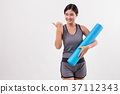 fitness yoga woman with yoga mat pointing away 37112343