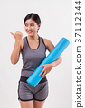 fitness yoga woman with yoga mat pointing away 37112344