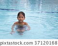 8 years old Asian kid swimming in swimming pool 37120168