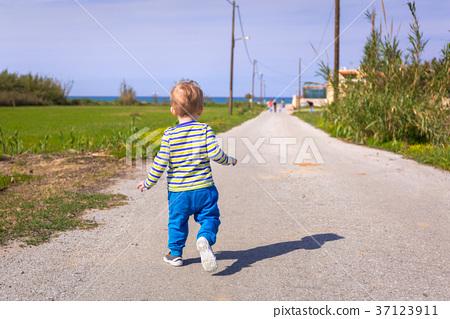 Little boy running on the road on Crete, Greece 37123911