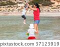 family, beach, baby 37123919