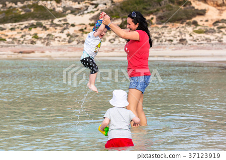Mother with son having fun in the water, Greece 37123919