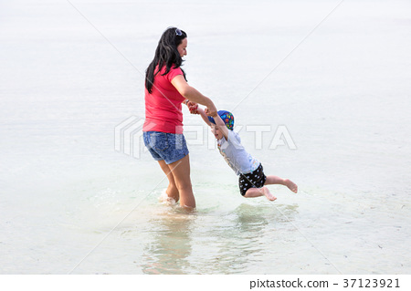 Mother with son having fun in the water, Greece 37123921
