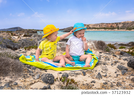 Boy and girl twins on Elafonissi beach on Crete 37123932