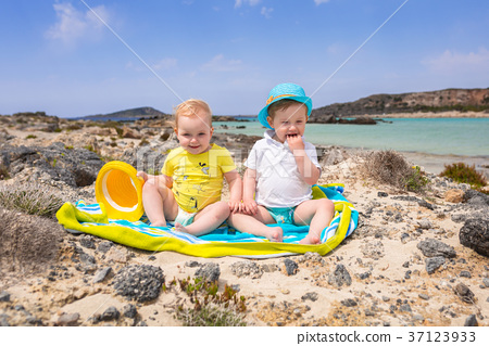 Boy and girl twins on Elafonissi beach on Crete 37123933