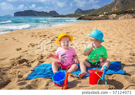 Twins on the beach holidays in Greece 37124071