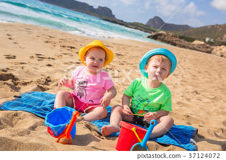 Twins on the beach holidays in Greece 37124072