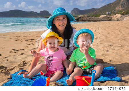 Mother with twins on sun holidays in Greece 37124073