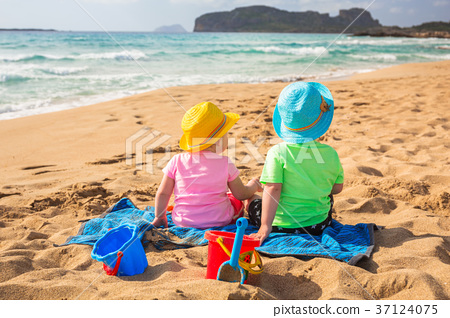 Twins on the beach holidays in Greece 37124075