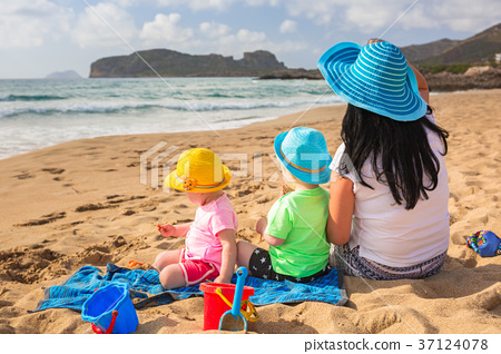 Mother with twins on the beach holidays in Greece 37124078