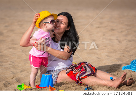 Mother and daughter having fun on sun holidays 37124081
