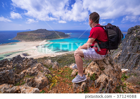 Man with backpack watching beautiful Balos beach  37124088