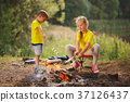 happy children hiking in the forest 37126437