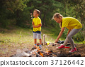 happy children hiking in the forest 37126442
