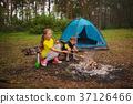 happy children hiking in the forest 37126466
