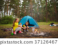 happy children hiking in the forest 37126467
