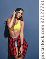 Fashion pretty young girl wearing a cap and 37127731