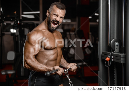 Old brutal strong bodybuilder athletic men pumping up muscles wi 37127918
